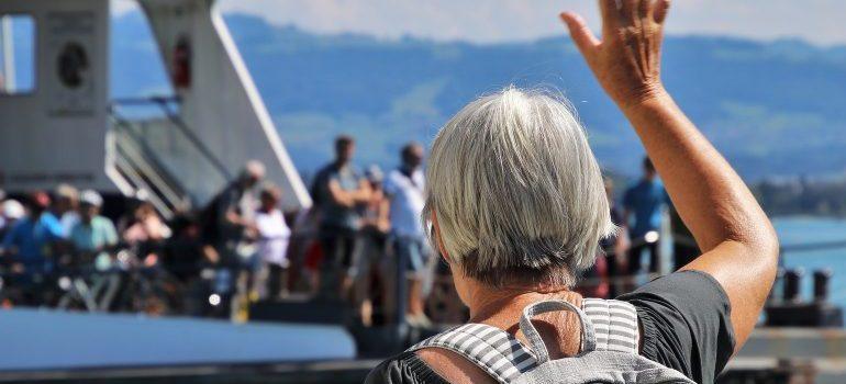 older woman waving