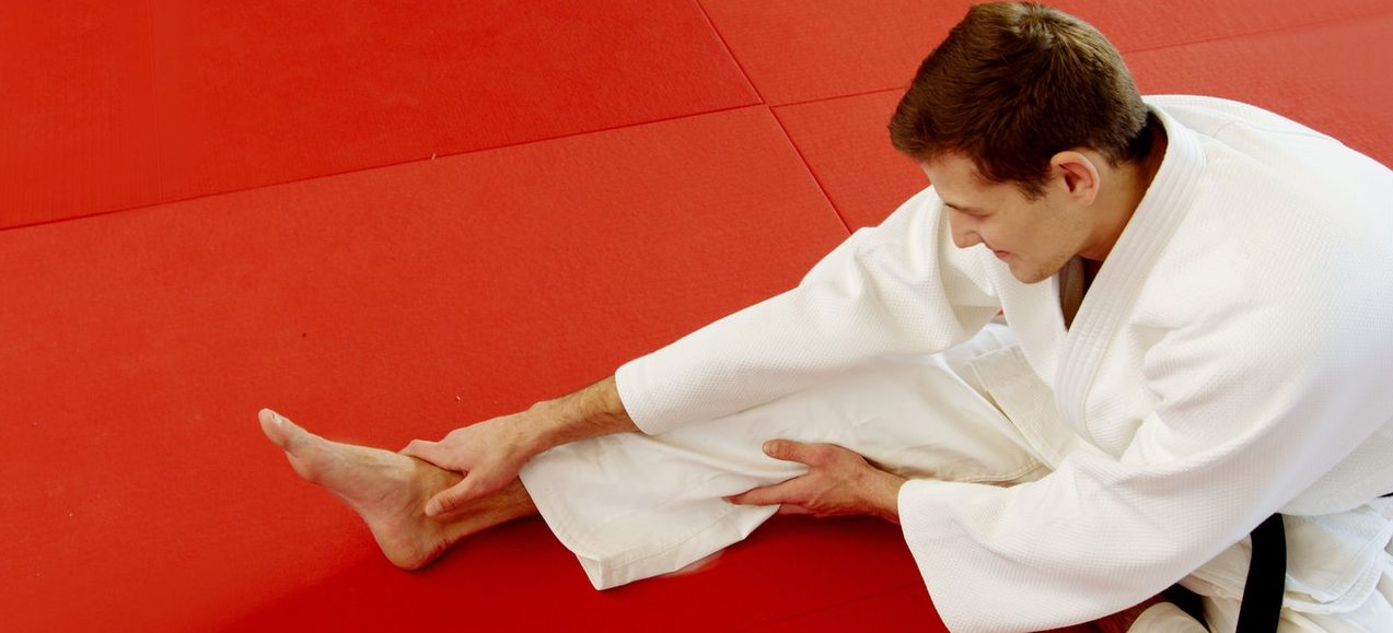 A man stretching after karate practice.