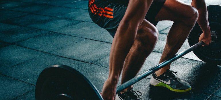 a man lifting a weight