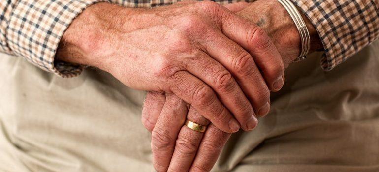 A close-up of the hands of an elderly man.
