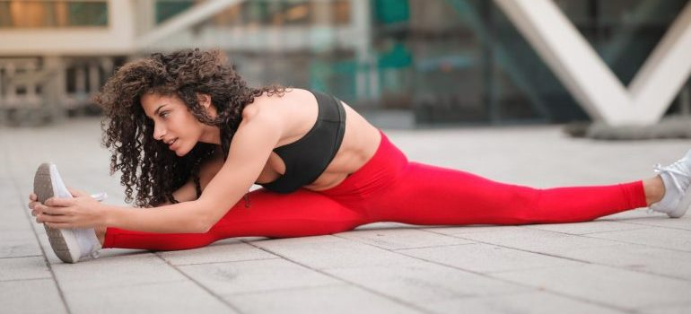 Woman stretching as a perfectly balanced week of workouts.