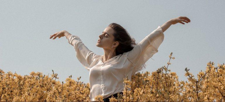 A woman relaxing in a field.