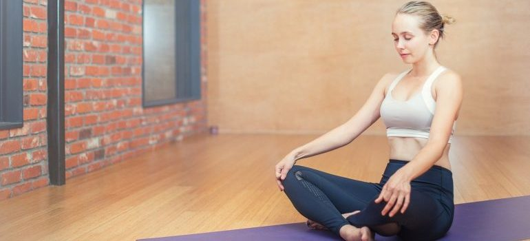 A woman relaxing in a yoga position.