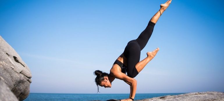 A woman in a complicated yoga pose, one of the benefits of taking private yoga classes.