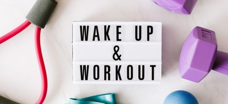 Wake up & workout sign on a lightbox