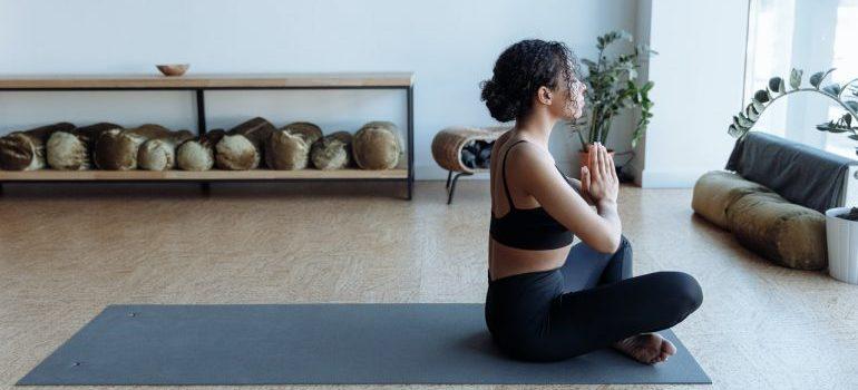 Woman doing yoga on the mat