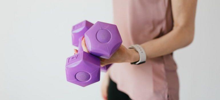 woman holding dumbbells