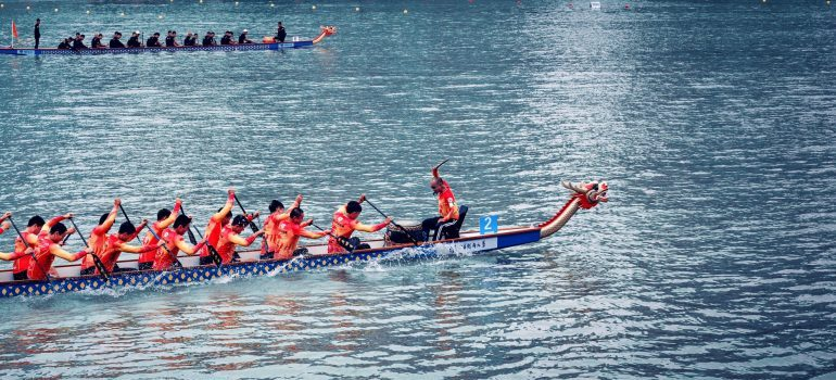 A team of rowersrowing a dragon boat.