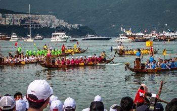 Contestants rowing in Waterfront Market Dragon Boat Challenge 2021