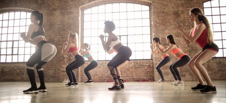 A group of women doing ZUmba.