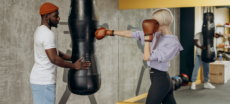 Woman boxing with a coach