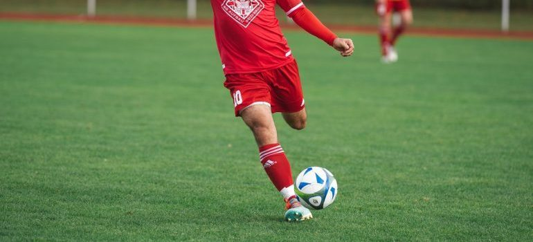 a man in a red jersey playing football