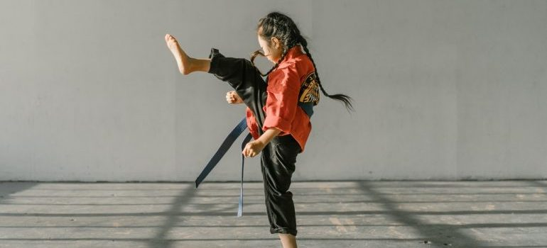 a girl demonstrating a kick in martial arts