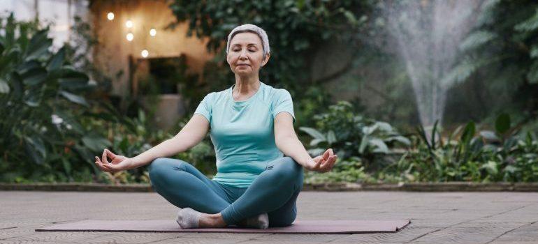 woman practicing yoga for seniors
