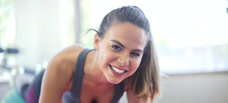 woman smiling while excercising
