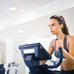 woman working out on an elliptical