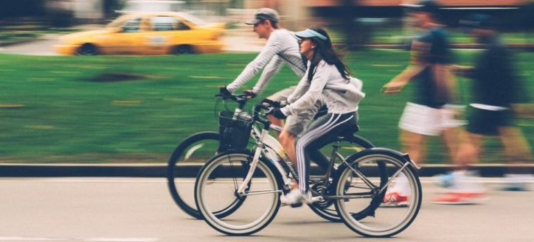 a woman and man cycling
