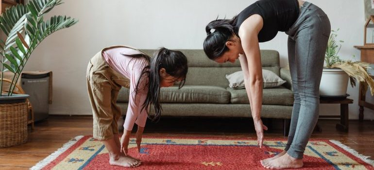 Mother and daughter practicing yoga.