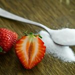 A sugar pile and a strawberry - sugar and fitness