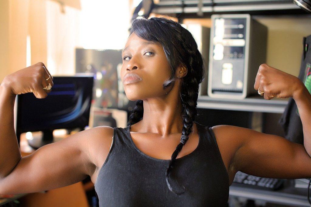 a girl flexing muscles