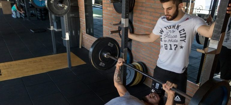 Fitness coach with a client