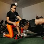 A trainer helping her clients maintain a weight loss