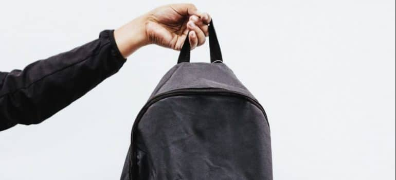 person holding a gym bag