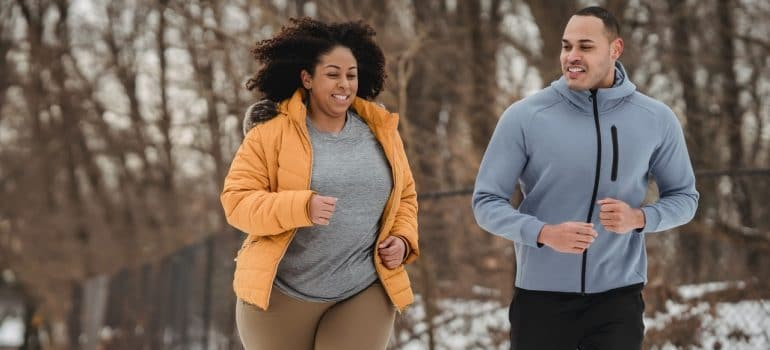 People running during winter
