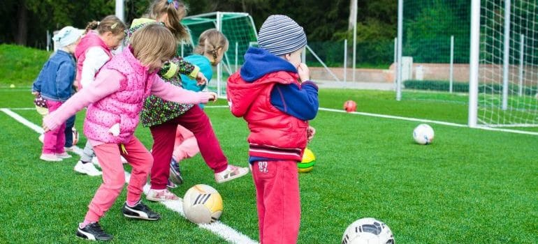 A group of young kids at a football practice.