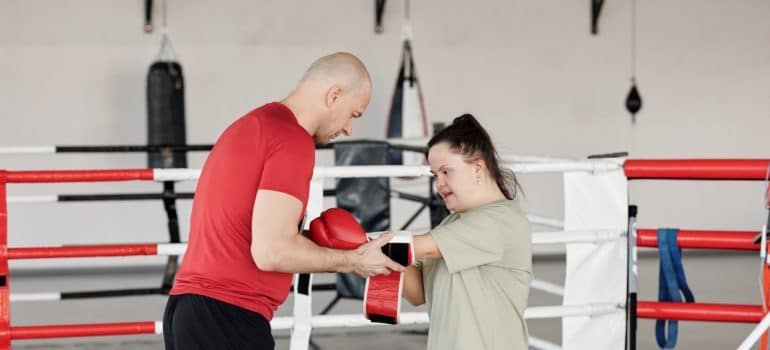 affordable personal trainer in Dubai helping a girl
