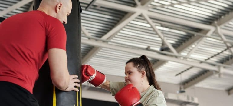 a girl training with affordable personal trainer in Dubai