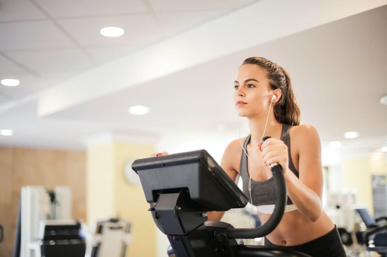 Girl exercising inside of a gym.