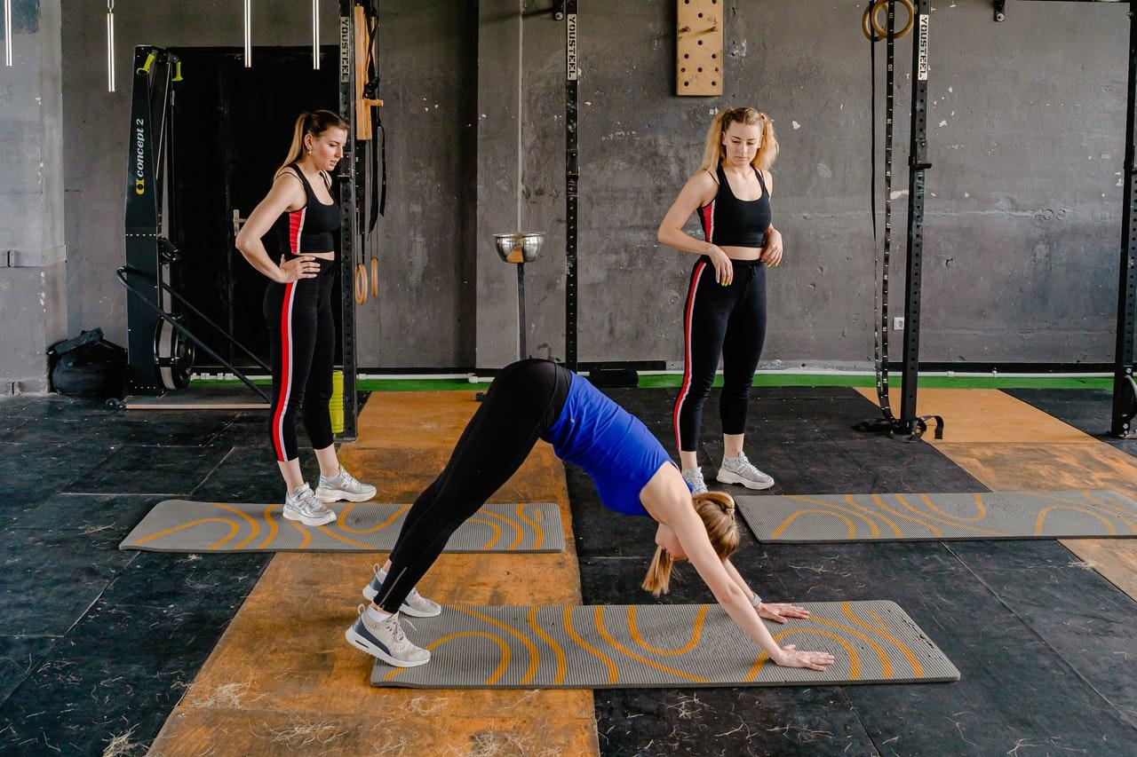 Three girls exercising together.