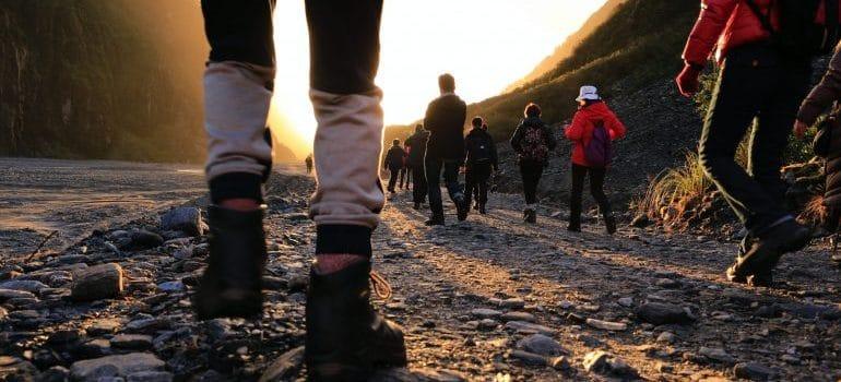 people walking down a hiking trail