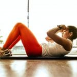 girl doing apartment-friendly workouts that won't tick off your neighbors