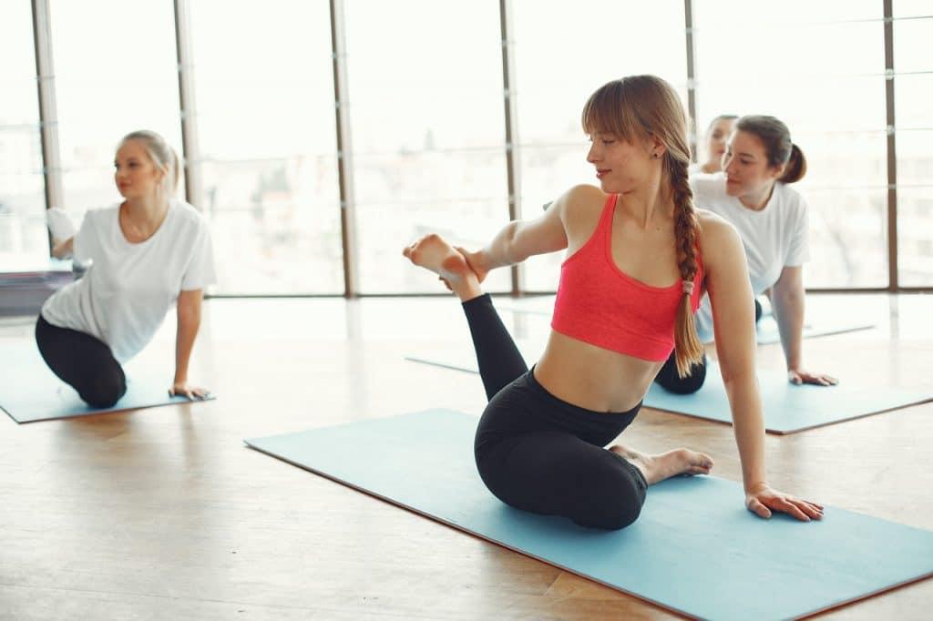 Girls doing exercises on yoga matts.