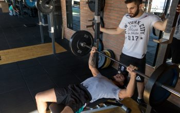two men working out at the gym