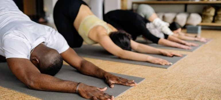 People stretching on yoga
